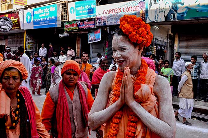 Culture- Naga Sadhu\u2019s (India) - A foreign Women Naga Sadhu greeting local people in Varanasi. by Anil Sharma Photography