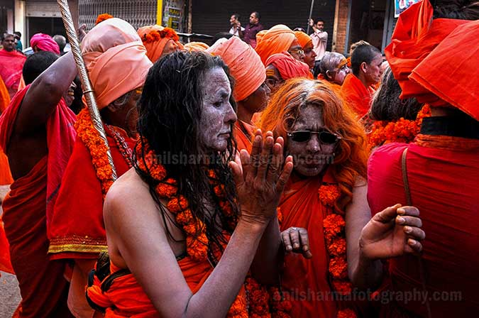 Culture- Naga Sadhu\u2019s (India) - Women Naga Sadhu's procession passing through the streets of Varanasi. by Anil Sharma Photography