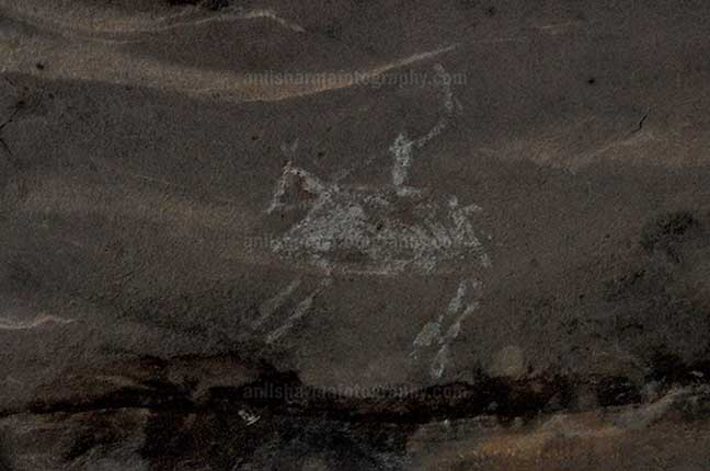Archaeology- Bhimbetka Rock Shelters - Prehistoric Rock Painting of a men riding horse in white color at Bhimbetka archaeological site by Anil Sharma Photography