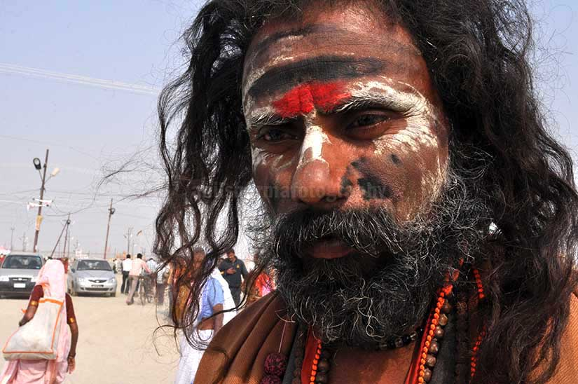 Culture- Aghori Sadhu\'s (India) - Aghori Sadhu with long hairs, ash and tilak on face wearing rudraksha bead at Mahakumbh mela, Allahabad, Uttar Pradesh, India. by Anil Sharma Photography