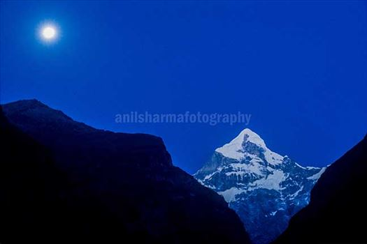 Nature-  Neelkanth Peak - Snow covered Neelkanth Peak on full moon night at Uttarakhand, India.