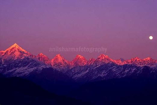 Nature-  Panchchuli Peaks - Pink color Panchchuli Peaks and full moon in the sky view from Munsyari at Uttarakhand, India.